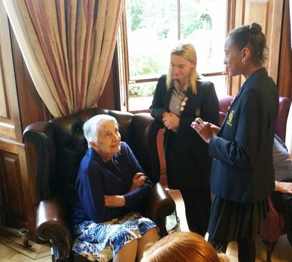 Upper Fifth students visitng the residents of Winscombe Hall
